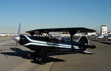Dark blue and white Skybolt in Pitts markings.